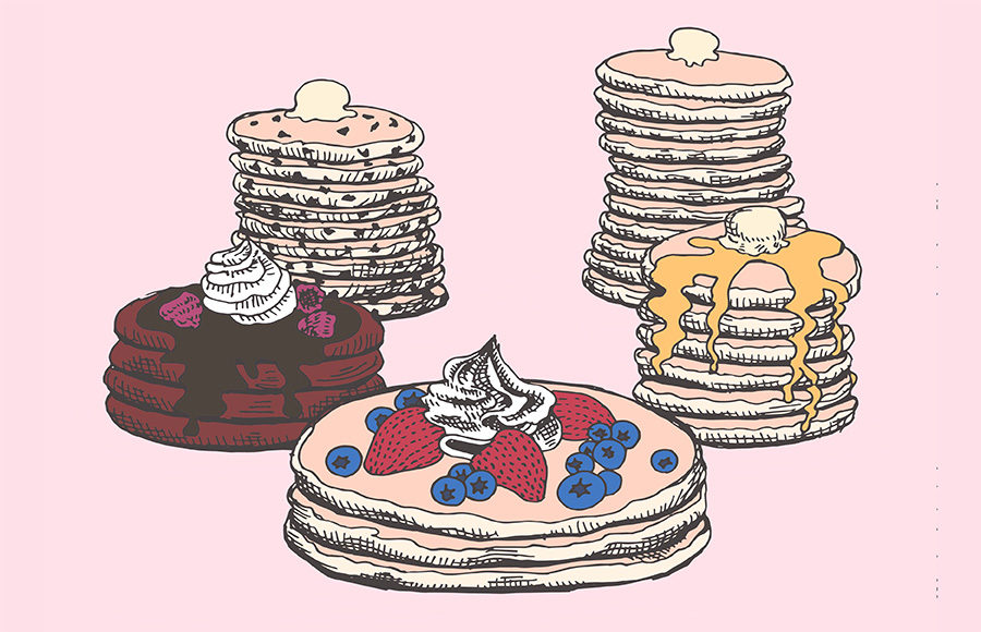 Stacks of blueberry pancakes, red velvet pancakes, and chocolate chip pancakes