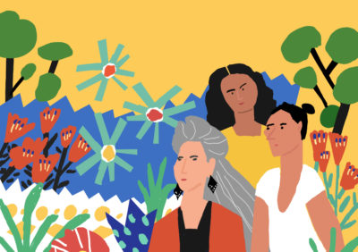 Three women of different ages surrounded by trees and flowers