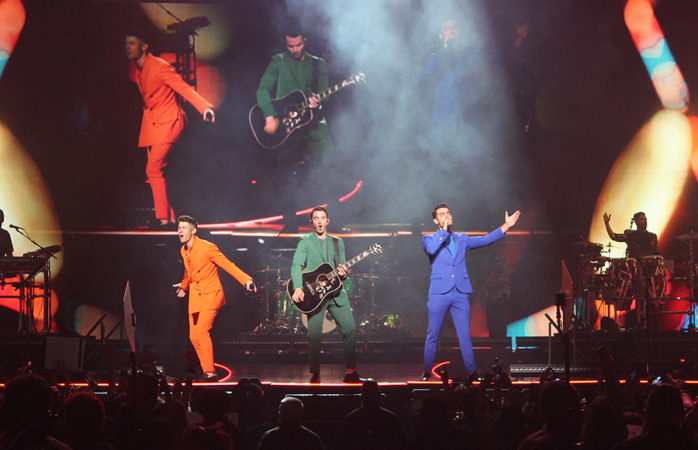 Jonas Brothers build an empire to burn it down in 'Happiness Begins' tour