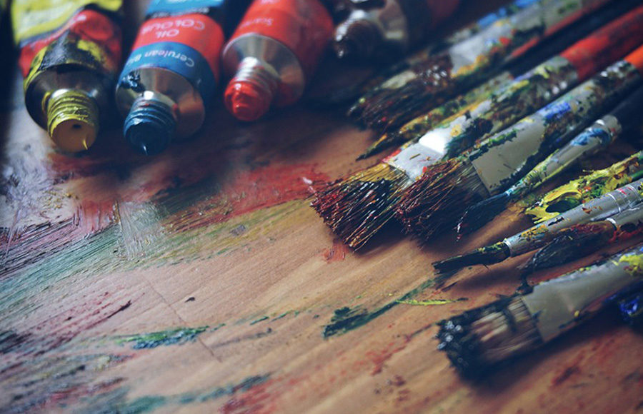 Photo of paints and paintbrushes