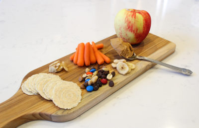 Photo of a snack platter (carrots, crackers, apple)