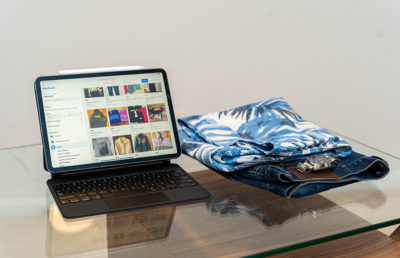 Photo of Facebook's Free & For Sale page and a stack of clothes