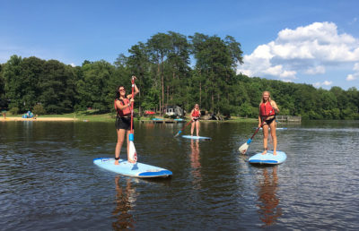 Photo of individuals paddleboarding