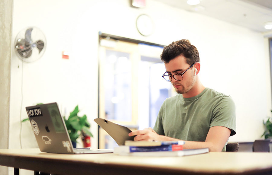 Photo of an individual studying at a desk