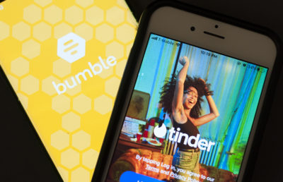 Photo of Bumble / Tinder apps open on an iPhone