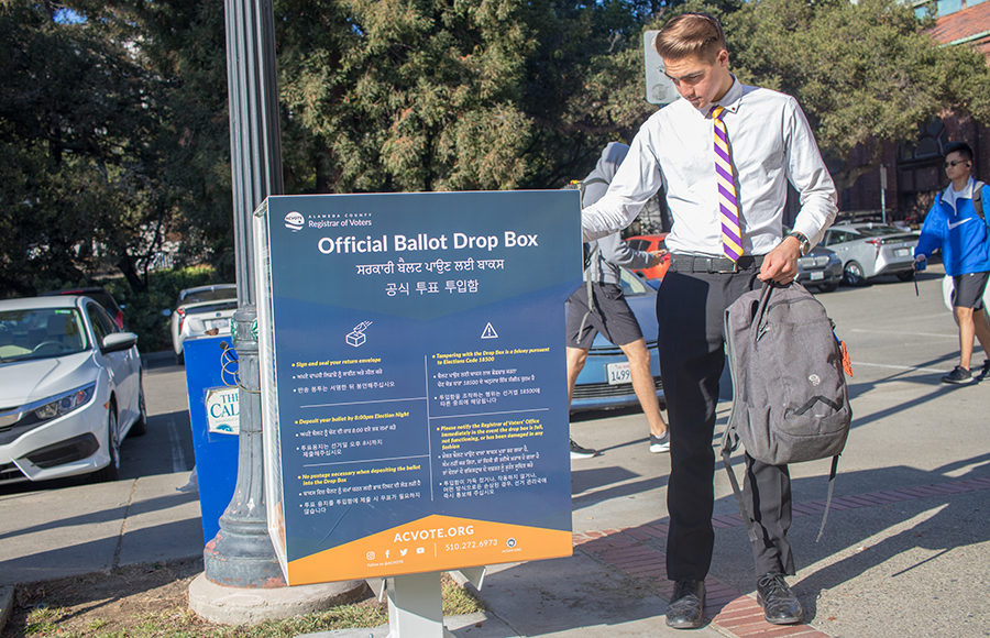 Photo of a student dropping off a ballot