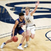 Photo of Lars Thiemann of Cal Men's Basketball guarding a Washington defender