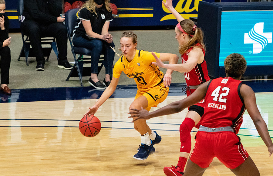 Photo of Mia Mastrov of Cal Women's Basketball driving to the hoop
