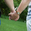 Photo of two people holding hands