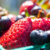 Photo of a basket of strawberries and blueberries
