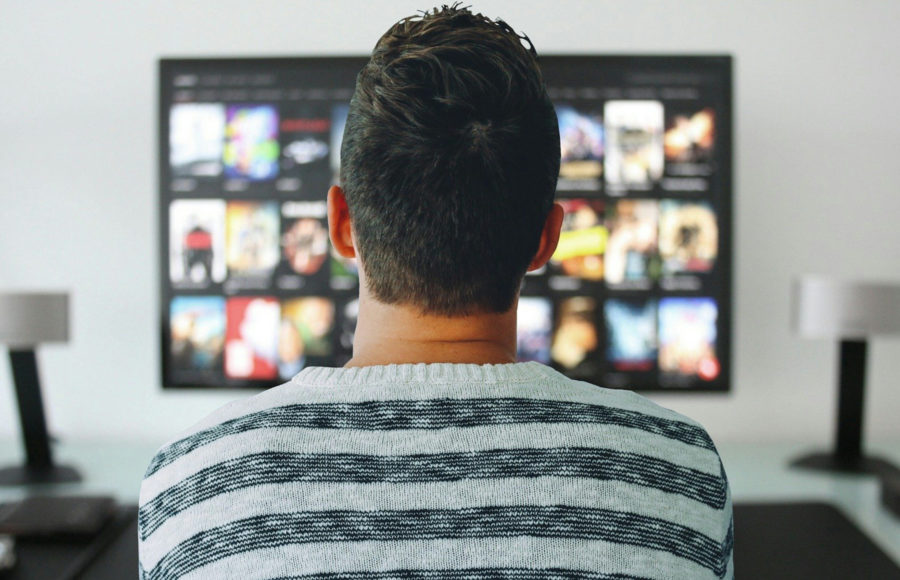 Image of man watching television