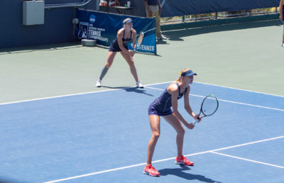 photo of Berkeley women's tennis team playing a match