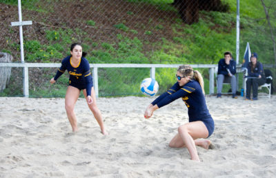 photo of 2 beach volleyball players