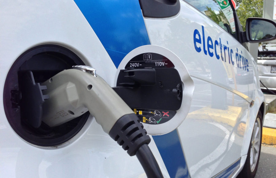 photo of electric car being charged