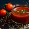 photo of tomato sauce in glass bowl