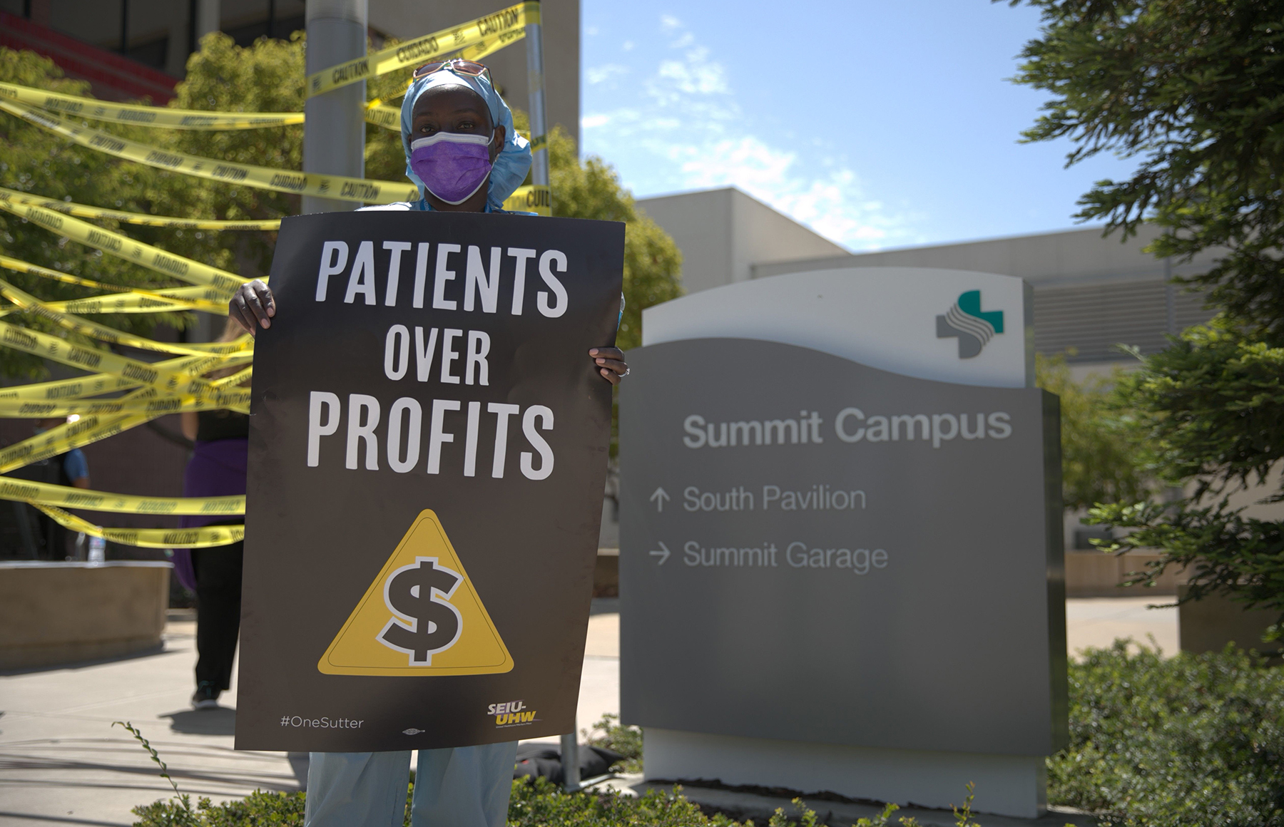 Protestors rally at Alta Bates Summit Medical Center to support health care worker, patient safety