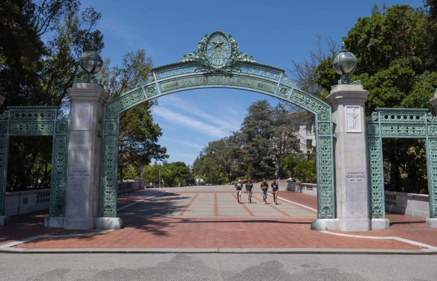 photo of students walking by Sather Gate