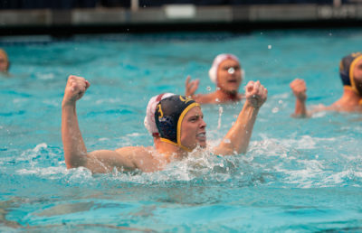 photo of a Cal men's water polo player celebrating in the pool