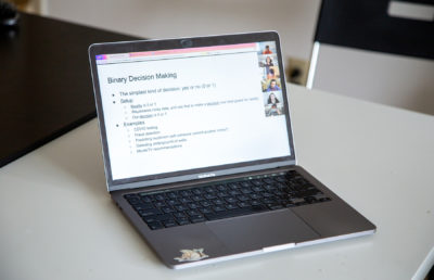 photo of a laptop with a zoom lecture open
