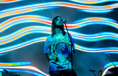 photo of Tame Impala during a concert