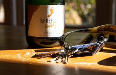 photo of a wine bottle and car keys