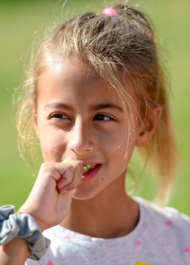 Matilda Lucia, 8, eats peas picked ...