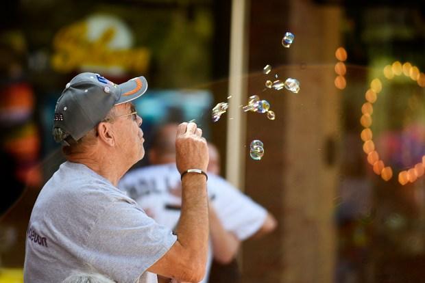 John Nyman blows bubbles at the ...