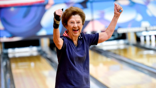 Donna Angstead celebrates a strike while ...