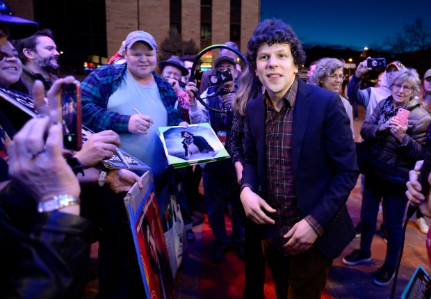 Jesse Eisenberg signs posters and other ...