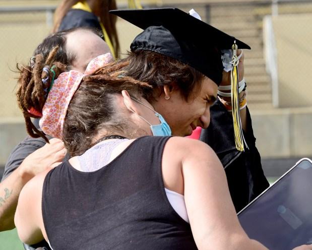 Jen Klimowicz hugs her son, Zehn, ...