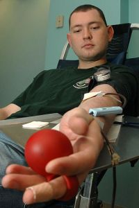 English: OFFUTT AIR FORCE BASE, Neb.,- Staff Sgt. Adam Wolfing, imagery analyst for the 20th Intelligence Squadron, donates blood to the American Red Cross Nov. 7. The American Red Cross goal for this blood drive was 38 units of blood. (Photo credit: Wikipedia)