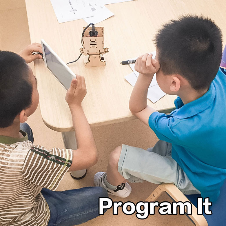 DIY Interactive Robot Building Kit with Face Detection and Visual Programmable Interface