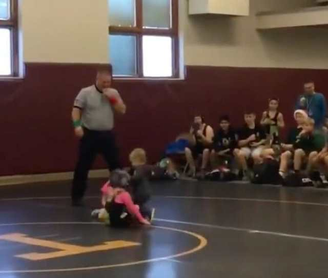 Watch A Little Brother Try To Defend His Sister During A Wrestling Match