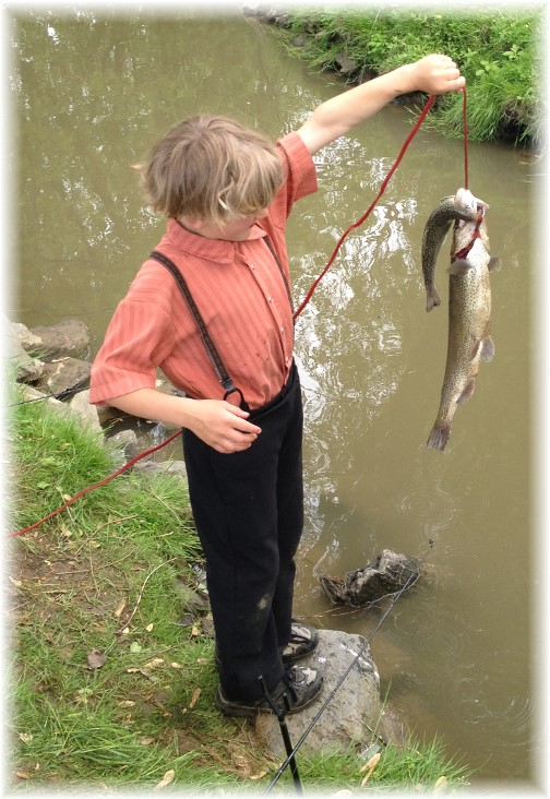 Amish boy holding fish 5/16/15