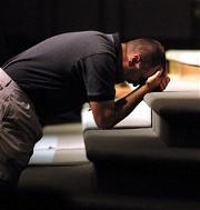 Man praying at altar