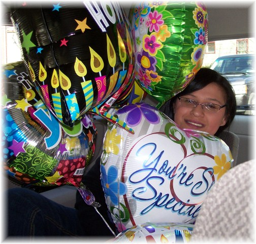 Ester at 23 with balloons