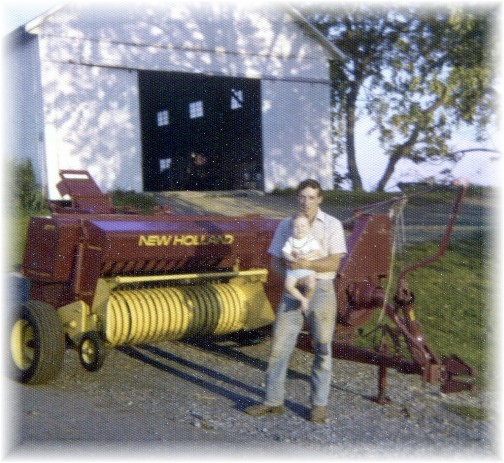 Galen with oldest son and new baler