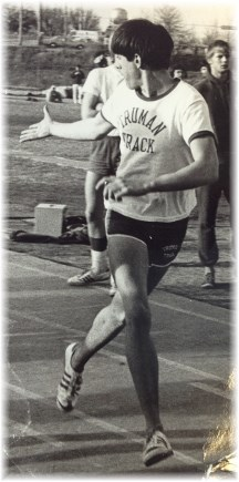 Stephen running track relay in high school