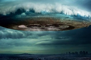 UFO/Alien spacecraft emerging from clouds