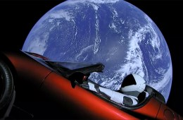 'Starman' sitting in a Tesla Roadster in space