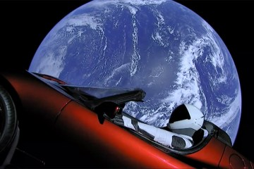 'Starman' sitting in a Tesla Roadster in space