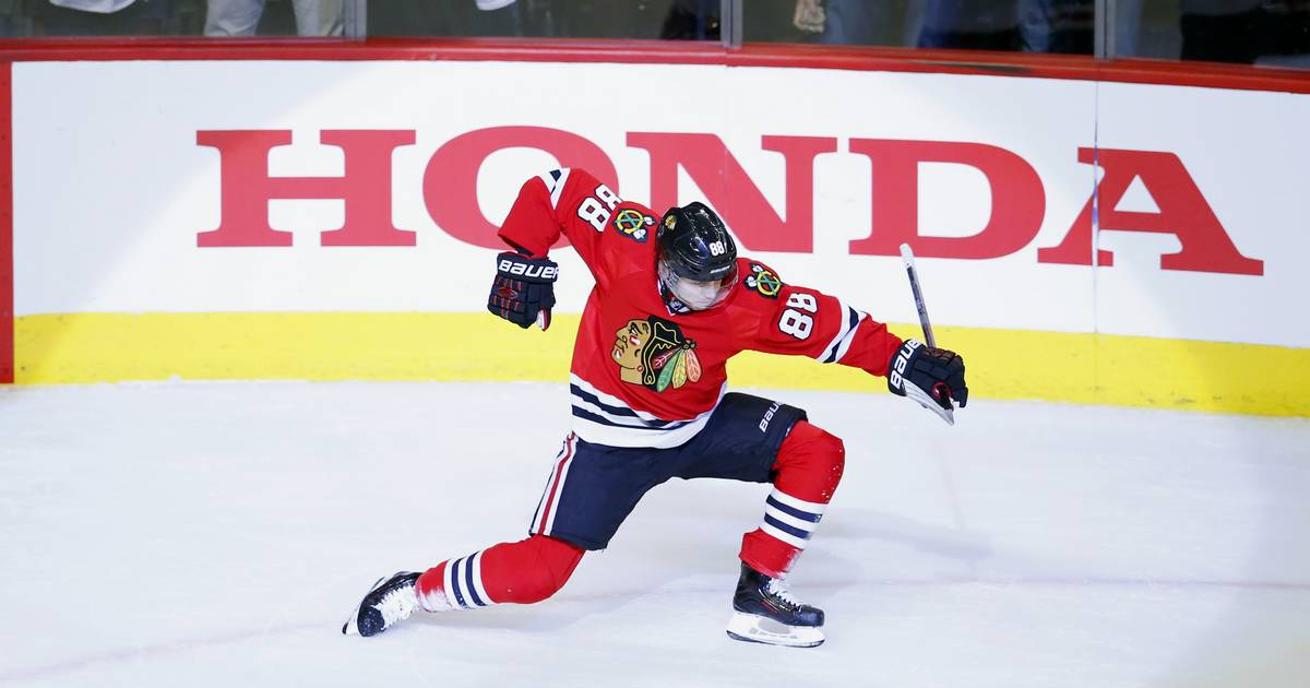 Kane Nets Hat Trick Gets 100th Point In Blackhawks Victory