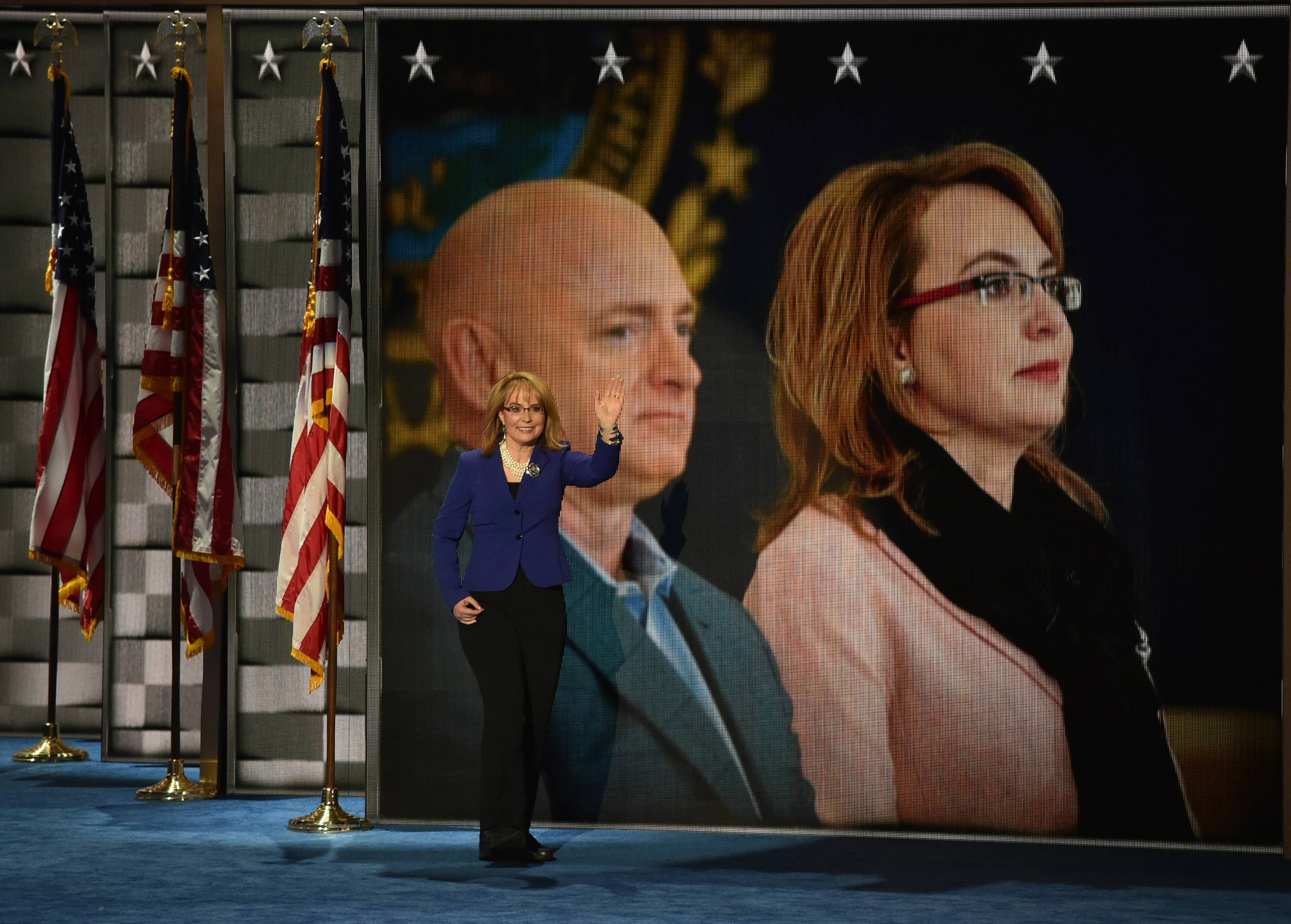 Former Rep.Gabby Giffords walks to the podium during the third day of the Democratic National Convention.