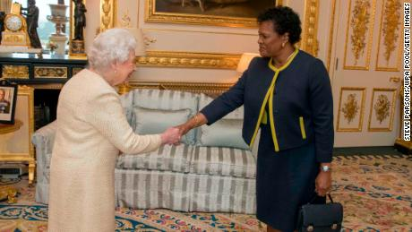Marcus receives the Queen at Buckingham Palace in 2018 in a private audience, Barbados pilot general.