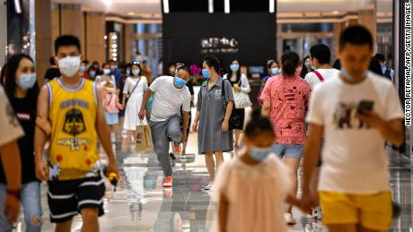 China & # 39;  to join the global slump was recovered shrugs off to shoppers in for economy,