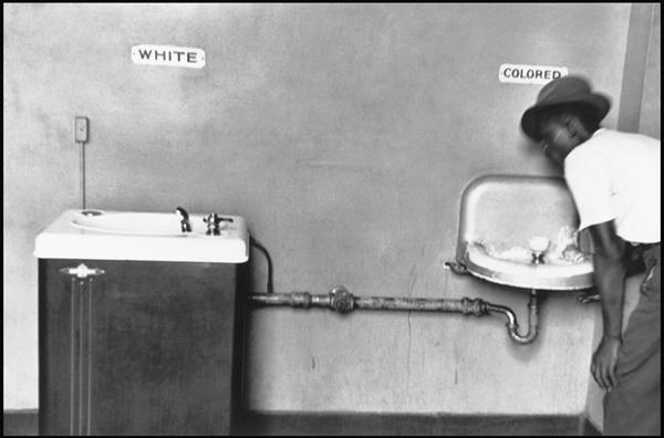 Taken by Elliot Erwitt. Symbolises the apartheid in africa, the discrimination they faced against the oddness.