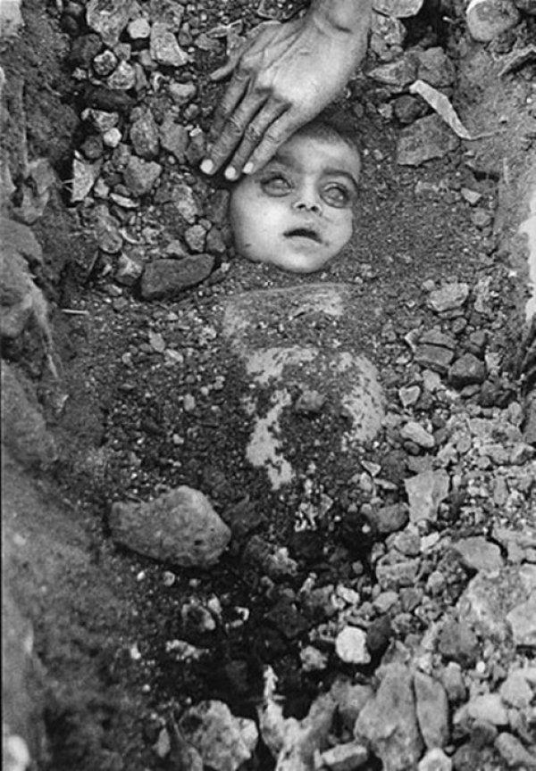 Taken by Raghu Rai, a Indian Photojournalist, who was asked to join by Henri-cartier-Bresson. This Picture was made on the Chemical Disaster in Bhopal during 1984. He even did exhibit the pictures to support the survivors of the disaster.
