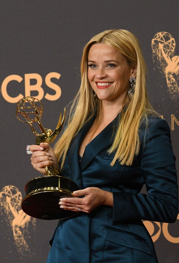 "Reese Witherspoon poses in the press room with the award for outstanding limited series for ""Big Little Lies""J at the 69th Emmy Awards on Sunday, Sept. 17, 2017 at the Microsoft Theater in Los Angeles, California. (Photo by Michael Owen Baker / SCNG)"