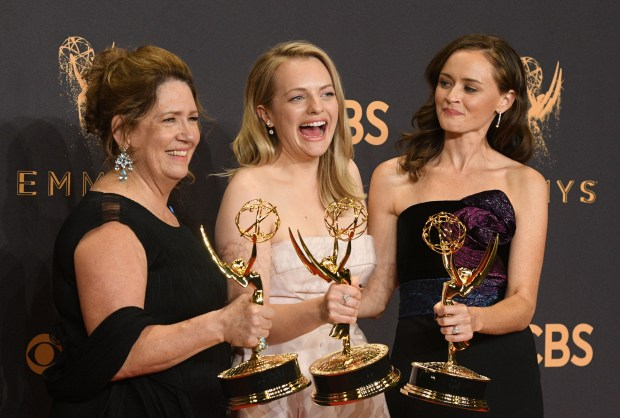 "Ann Dowd winner of outstanding supporting actress in a drama series, Elisabeth Moss winner of outstanding lead actress in a drama series and Alexis Bledel winner of outstanding guest actress in a drama for ""The Handmaid's Tale"" (l-r) at the 69th Emmy Awards on Sunday, Sept. 17, 2017 at the Microsoft Theater in Los Angeles, California. (Photo by Michael Owen Baker / SCNG)"