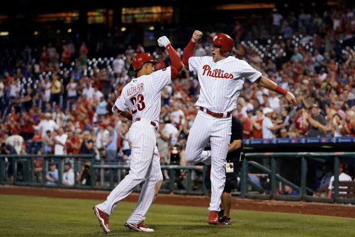 Philadelphia Phillies' Rhys Hoskins, right, and Aaron Altherr celebrate after Altherr's two-run home run during the seventh inning of a baseball game against the Los Angeles Dodgers, Wednesday, Sept. 20, 2017, in Philadelphia. Philadelphia won 7-5. (AP Photo/Matt Slocum)